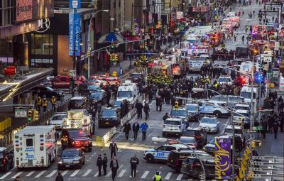 Law enforcement officials work following an explosion near New York's Times Square on Monday, Dec. 11, 2017, in New York. Police said a man with a pipe bomb strapped to him set off the crude device in an underground passageway under 42nd Street between Seventh and Eighth Avenues. (ANSA/AP Photo/Andres Kudacki)