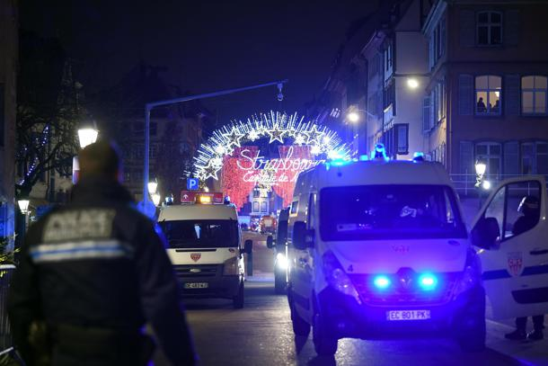 epa07224662 French police vehicles are parked near the shooting site at the Christmas Market in Strasbourg, Alsace, France, 11 December 2018. According to latest report, two people are dead and 11 people are injured. The gunman is reported to be at large and the motive for the attack is still unclear.  EPA/PATRICK SEEGER