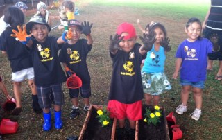 Gardening at Ele`ele School is lots of fun! Photo by Keone Kealoha