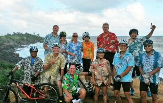 Ugly Aloha Shirt riders last December included (front row) Roland Tanicala, Tommy Noyes, Ugliest Aloha Shirt contest winner Bruce Whale, Audrey Valenciano, Steven Yee and Roy Yamagata. On back row: Scott McCubbins, Lori Stitt, Lori Benkert, Karen Yee, Larry LaSota, and Angelo Catiggay. Photo by Lem Soria