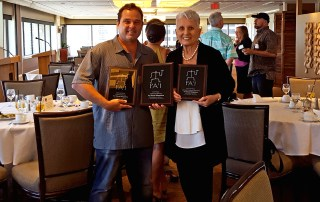 For Kaua'i owner and publisher Barbara Bennett and For Kaua'i editor in chief Léo Azambuja show the three Pa'i Awards from the Hawai'i Publishers Association the newspaper won in May 24 at the Plaza Club in Honolulu.