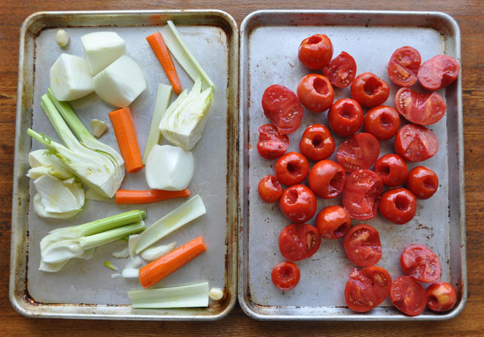 tomatoes and vegetables on pans