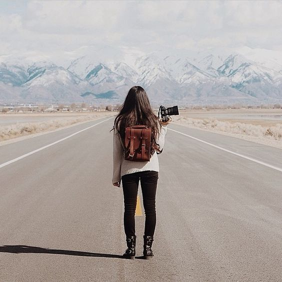Photographer by mountains