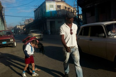 Mother talks to her child in the morning on the way to school. Habana Vieja, November, 2013.