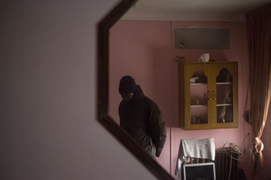 Kennedy stands waiting on his eviction day in his home in Madrid that he shares with his wife and three children whom he moved out a few days earlier. Kennedy took out a mortgage when the economy was strong but found his payments drastically increasing due to inflation leaving him unable to keep up with his mortgage.