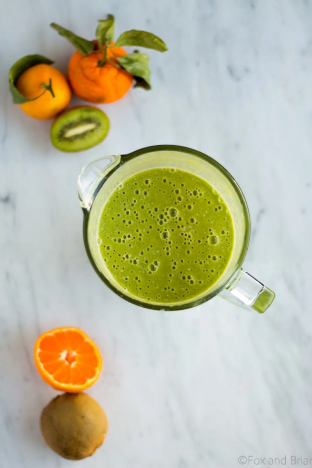 This Kiwi Satsuma Green Smoothie is the perfect winter smootie! Using the bright, tropical flavors of kiwis and satsuma, it will brighten up any dark winter morning.