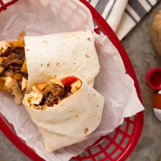 These Make Ahead Beef Breakfast Burrritos are freezer friendly!  Using tender, slow cooker shredded beef, breakfast potatoes, eggs and cheese, they can be made ahead of time and frozen.  Just reheat them in the morning for a quick and hearty breakfast!