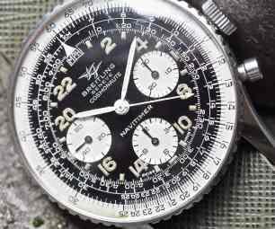 Vintage Breitling 809 Cosmonaute models often feature black, moisture-damaged lume