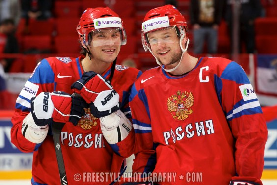 STOCKHOLM, SWEDEN - MAY 17: Russia's Alexander Ovechkin #8 and Ilya Nikulin #5 are all smiles after winning Team Norway and advancing to the semifinals during quarterfinal action at the 2012 IIHF World Championship. (Photo by Andre Ringuette/HHOF-IIHF Images)