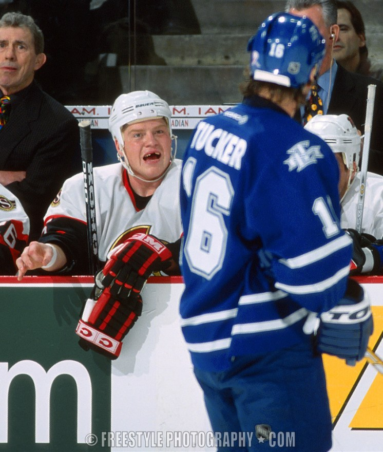 Chris Neil has a few choice words for long time rival Darcy Tucker. 2002 © Andre Ringuette/Freestyle Photography/OSHC