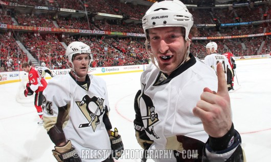 OTTAWA - APRIL 18: Brooks Orpik #44 of the Pittsburgh Penguins gestures to a fan through the glass after an altercation with the Ottawa Senators in Game Three of the Eastern Conference Quarterfinals during the 2010 NHL Stanley Cup Playoffs at Scotiabank Place on April 18, 2010 in Ottawa, Ontario, Canada. (Photo by Andre Ringuette/NHLI via Getty Images)