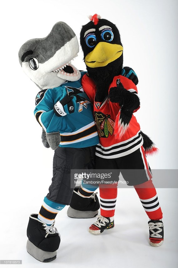 OTTAWA, ON - JANUARY 26: (L-R) S.J. Sharkie, mascot for the San Jose Sharks and Tommy Hawk, mascot for the Chicago Blackhawks pose for a portrait during 2012 NHL All-Star Weekend at Ottawa Convention Centre on January 26, 2012 in Ottawa, Canada. (Photo by Matt Zambonin/Freestyle Photo/Getty Images)