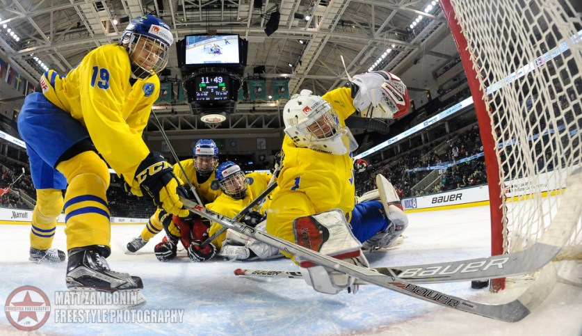 Sweden's Timothy Liljegren #19 and Filip Gustavsson #1 fail to stop the puck resulting in a Canada second period goal during semifinal round action at the 2016 IIHF Ice Hockey U18 World Championship. (Photo by Matt Zambonin/HHOF-IIHF Images)
