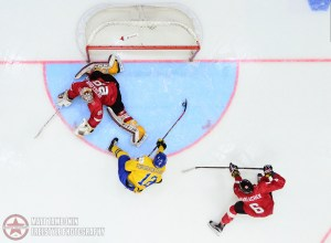 Sweden's Jakob Forsbacka Karlsson #12 pulls the puck by Switzerland's Gauthier Descloux #29 to score Team Sweden's sixth goal of the game during preliminary round action at the 2016 IIHF World Junior Championship. (Photo by Matt Zambonin/HHOF-IIHF Images)
