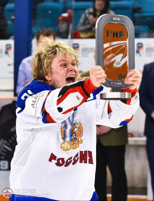 Russia's Anna Shukina #21 celebrates after a 1-0 victory over Finland during bronze medal game action at the 2016 IIHF Ice Hockey Women's World Championship. (Photo by Matt Zambonin/HHOF-IIHF Images)