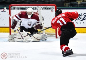 Latvia's Gustavs Grigals #29 makes a save against Switzerland's Dominik Volejnicek #11 in the third period during preliminary round action at the 2016 IIHF Ice Hockey U18 World Championship. (Photo by Matt Zambonin/HHOF-IIHF Images)