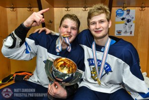 Finland's Eetu Tuulola #19 and Markus Niemelainen #21 celebrate with the trophy after a 6-1 victory over Sweden during gold medal game action at the 2016 IIHF Ice Hockey U18 World Championship. (Photo by Matt Zambonin/HHOF-IIHF Images)