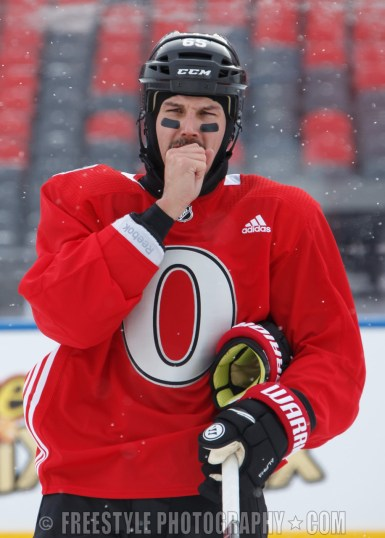 OTTAWA, ON - DECEMBER 15: Erik Karlsson #65 of the Ottawa Senators looks on during a practice session ahead of the Scotiabank NHL100 Classic, at Lansdowne Park on December 15, 2017 in Ottawa, Canada. (Photo by Andre Ringuette/NHLI via Getty Images)