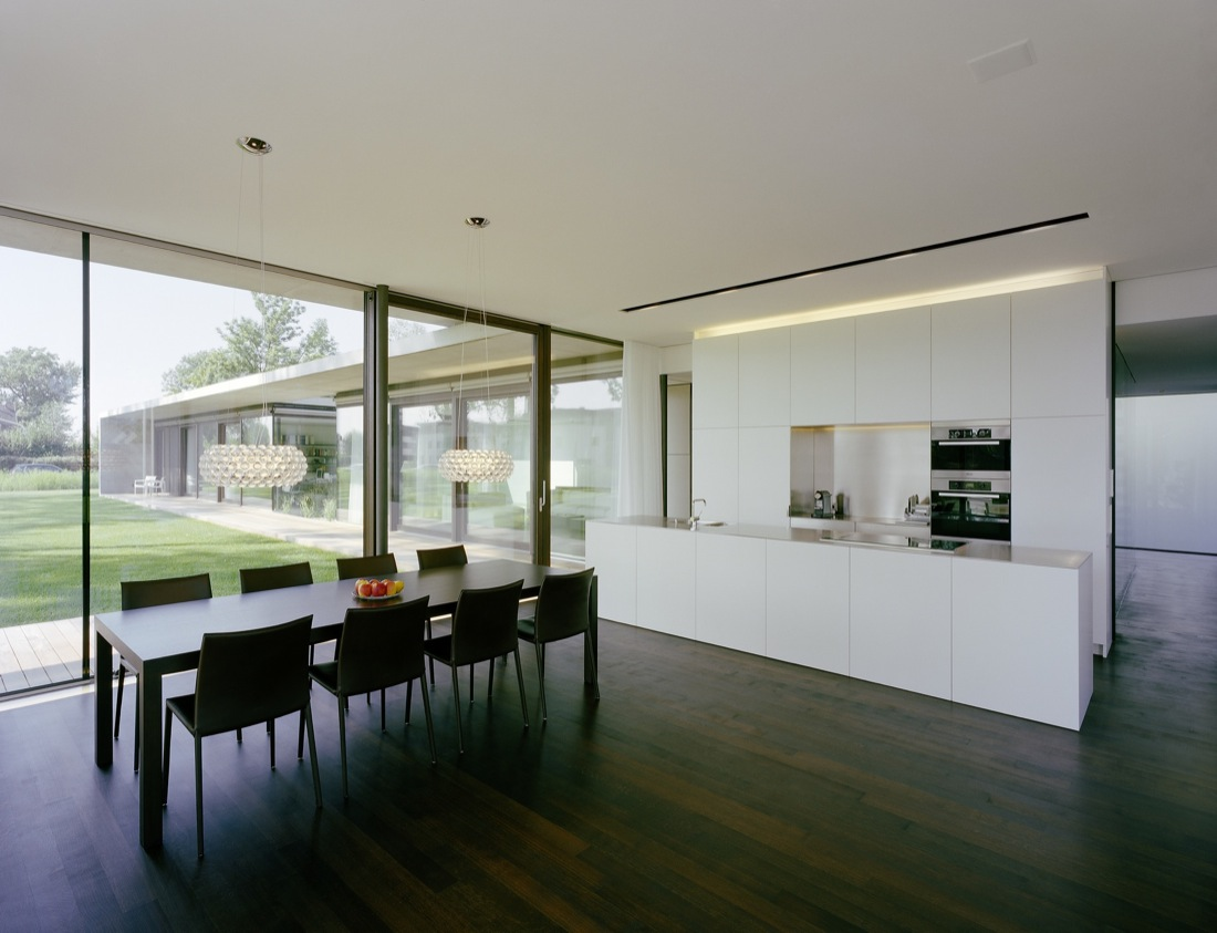 White Kitchen Dark Wood Floor Dining Table Cantilevered House in Hard Austria