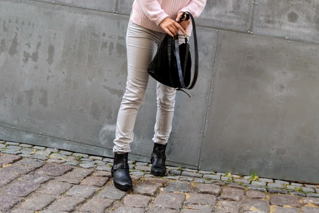 Pink jumper grey jeans and biker boots
