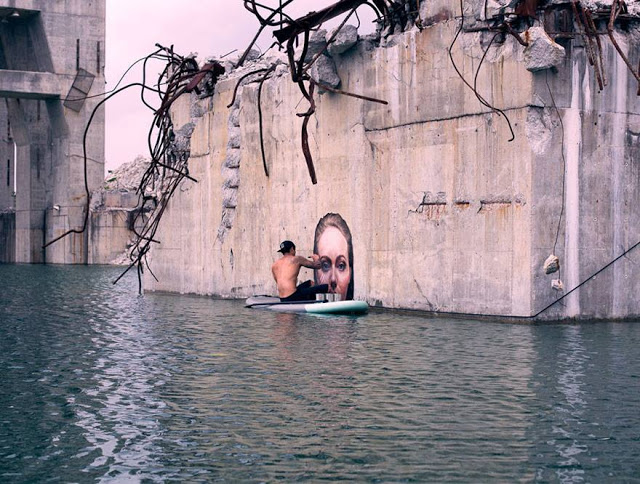 Sean yoro painting mural on surfboard