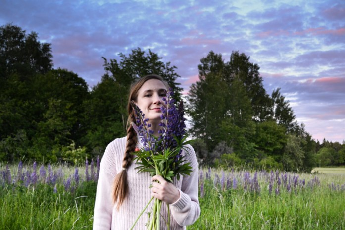 Girl in field of Lupins
