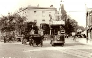 Pittville Gates in 1900s, with trams