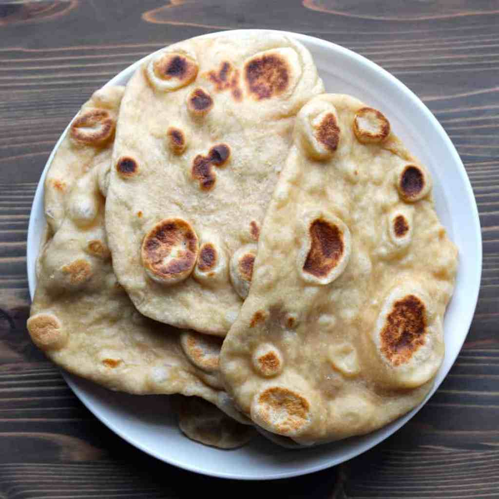 Easy Whole Wheat Naan by Frugal Nutrition #homemade #wholewheat #stovetop