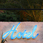 blue hotel sign on wall, corsica, france