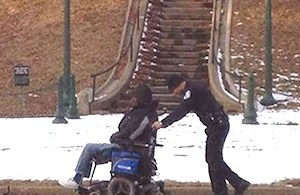 1 cop with wheelchair