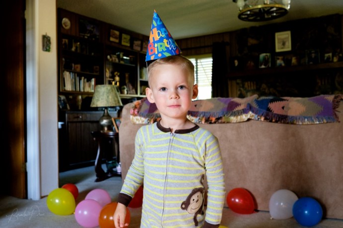 My nephew celebrating his third birthday at Great Grandma Bunny's house. (23mm f/1.4 @ f/4.0, 1/50, ISO 3200)