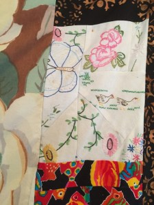 detail with cut up linens and fish fabric
