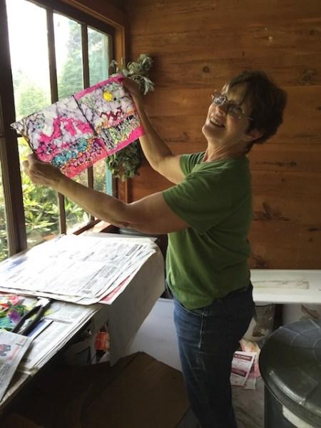 Carol Law Conklin with her latest batiks.