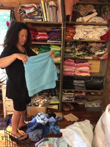Athena helping me fold my fabric