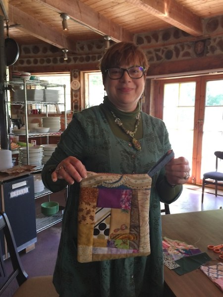 Sue and the potholder she made today.