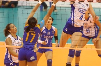 Pocari Sweat's Andrea Kacsits towers over Air Force's Jocemer Tapic for a hit during their Shakey's V-League Reinforced Conference encounter at the Philsports Arena.