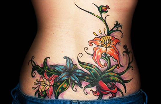 flower lower back tattoos