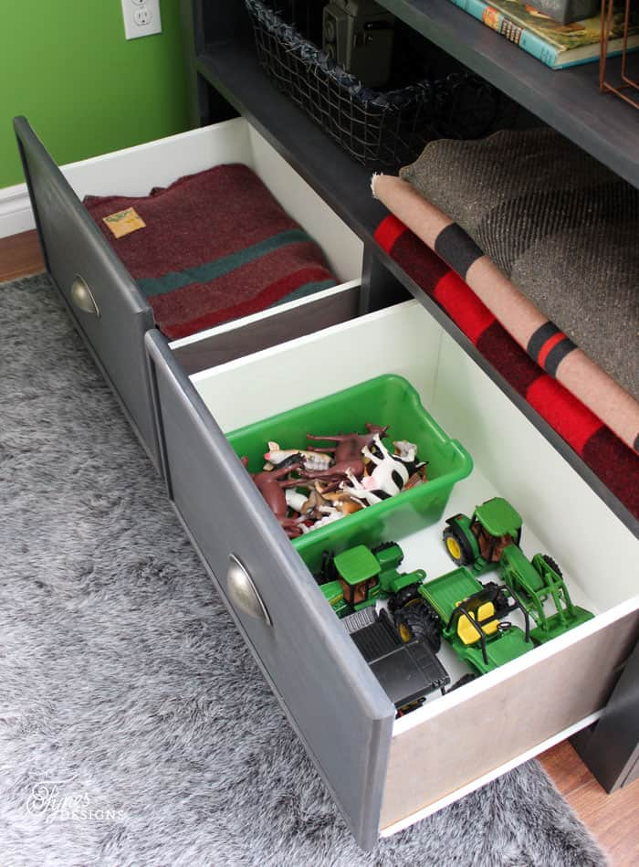 Bookcase drawers for storing blankets and tyous