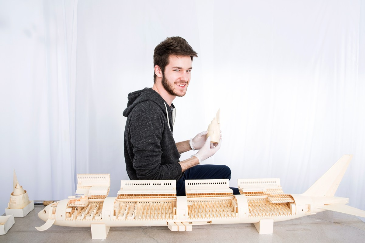 Luca Iaconi-Stewart and his hand made model 777 airplane from manila folders.