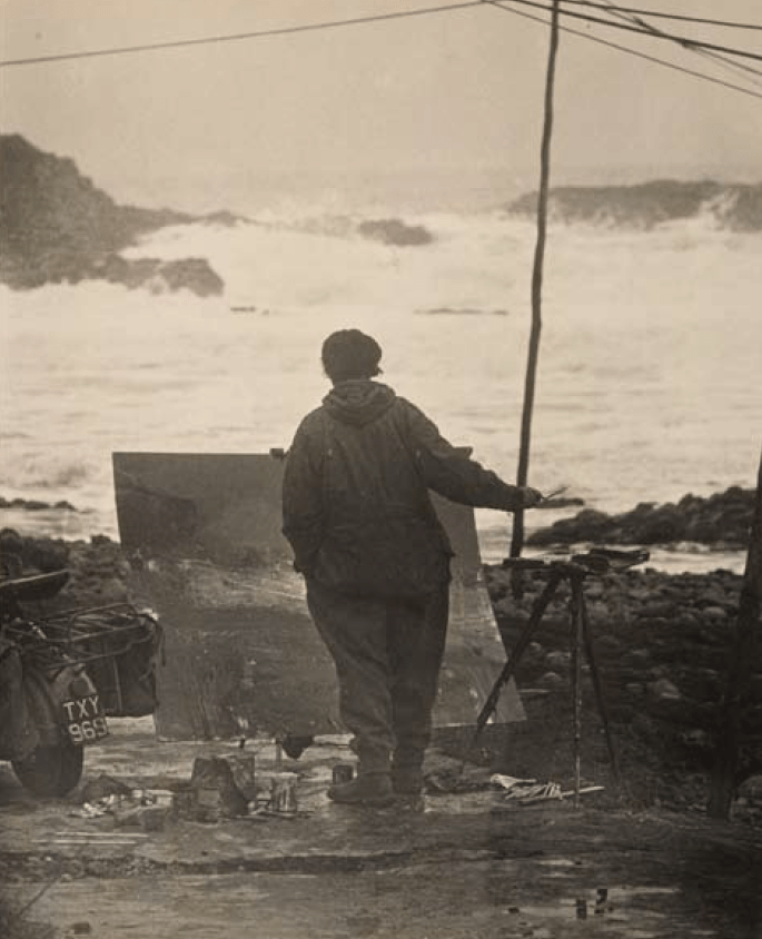 Joan Eardley painting at Catterline on a not so sunny day! Photo by Audrey Walker