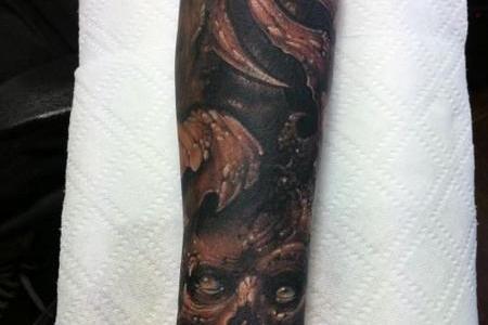 evil forearm tattoo 3