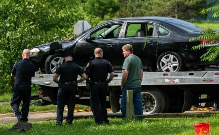 Police remove a black sedan from the Kalamazoo River near Verburg Park, Tuesday morning, June 18, 2019.