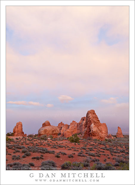 Sandstone Towers, Evening Sky - Evening clouds above sandstone towers and desert terrain, Arches National Park
