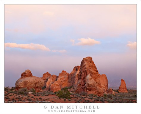 Sandstone Towers, Evening Clouds - Dissipating evening clouds above sandstone formations, Arches National Park, Utah