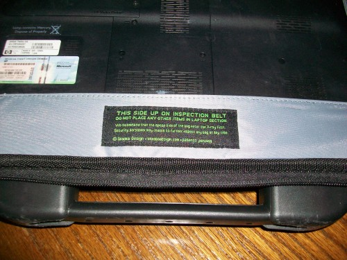 Warning label that you can only put your notebook in the PC slot