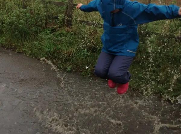Spotty Otter - splashing in puddles