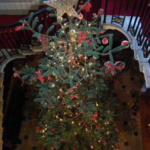 A huge Christmas tree in the marble stairwell