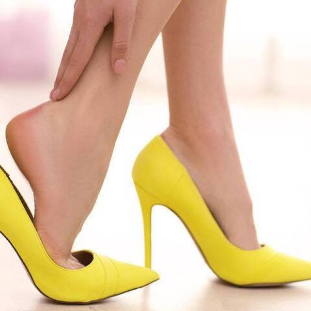 bigstock-Woman-taking-off-yellow-high-h-129251222
