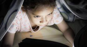 bigstock-A-Girl-Reading-On-The-Bed-100482716