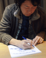 Artist and writer Okubo sketching the main character, Maka Albarn.